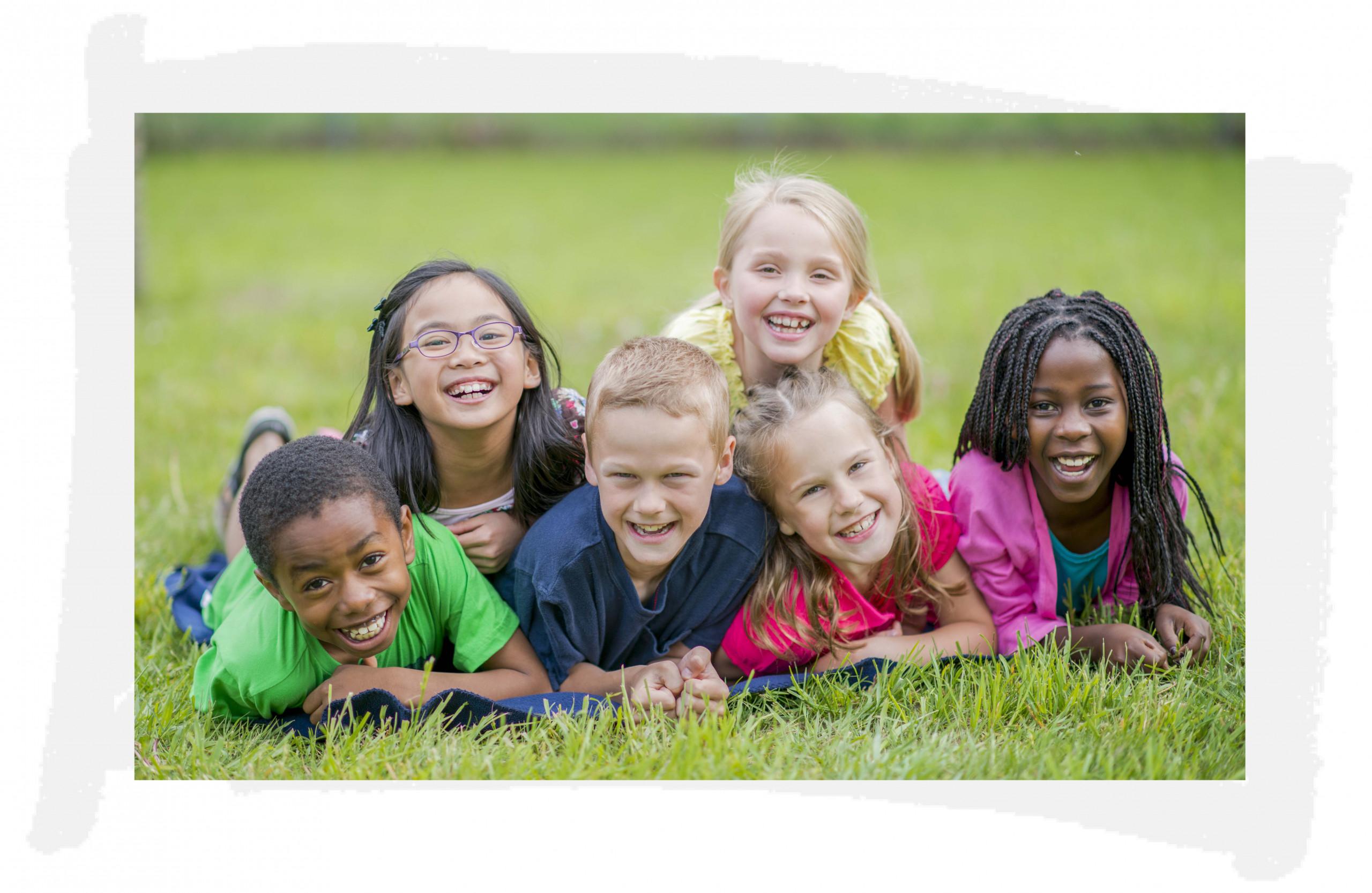 happy children smiling outside