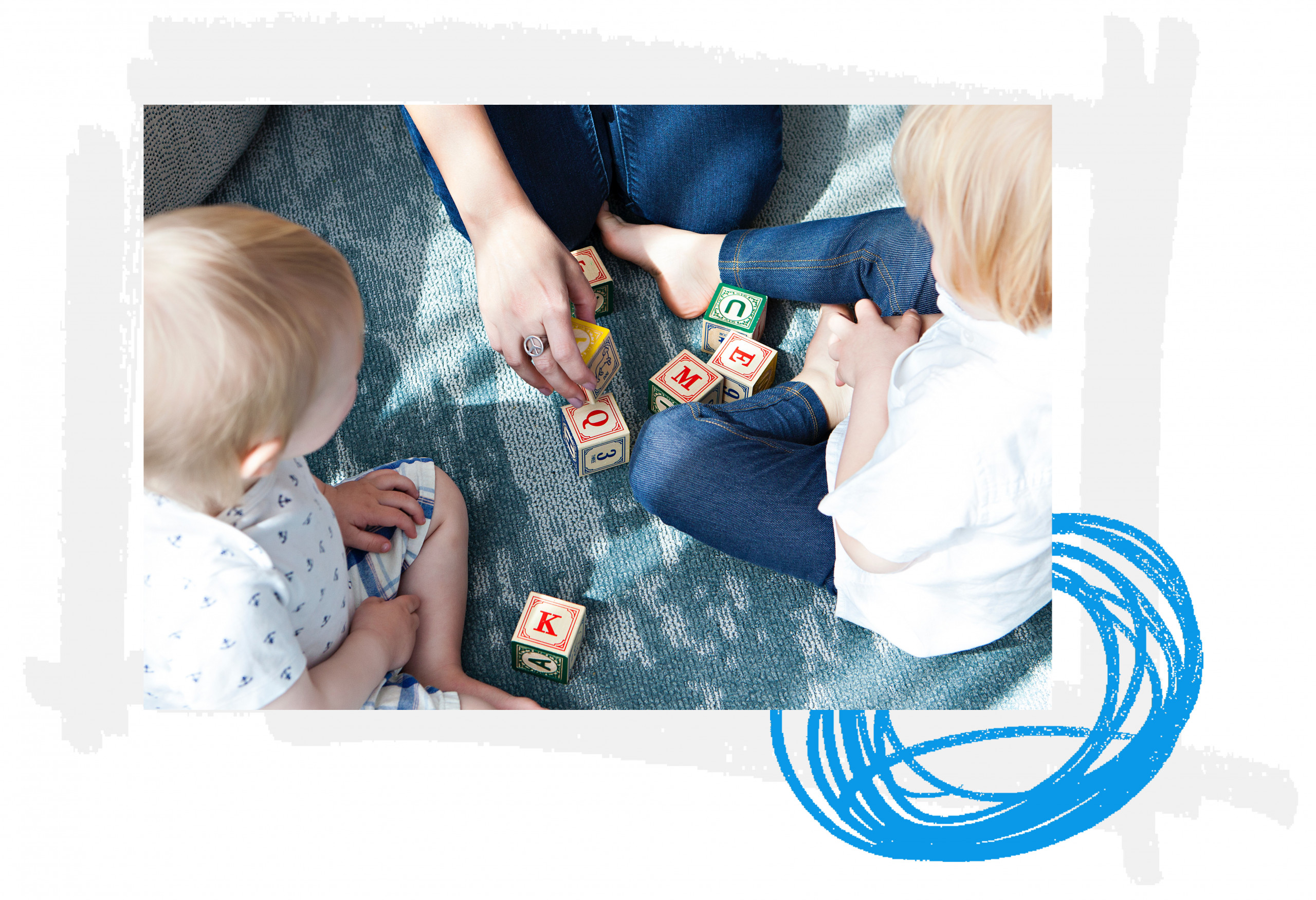 children and therapist playing with blocks